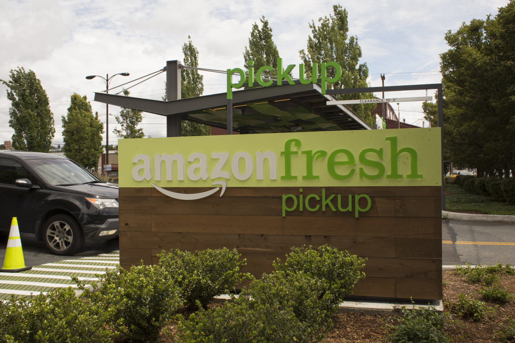 A car drives past an AmazonFresh Pickup location on June 16, 2017 in Seattle, Washington.