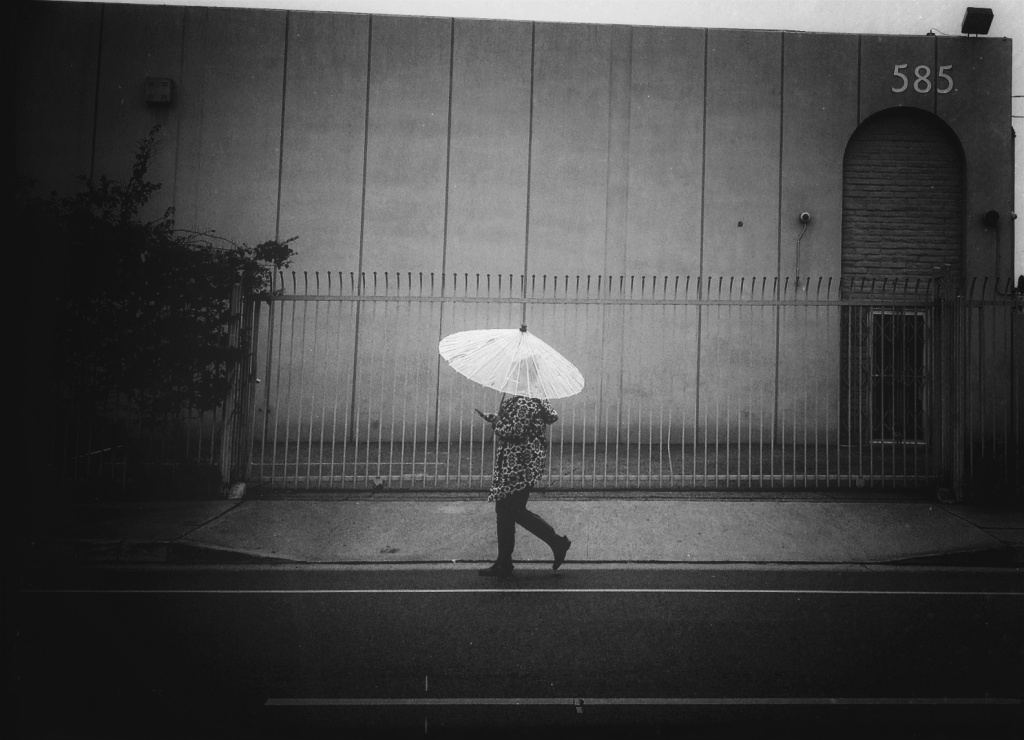 A stock photo of a woman walking on a rainy day in L.A.
