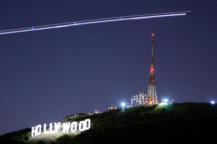 The Hollywood Sign illuminated by the spotlight of a helicopter streaking past the sign at night on Nov. 16, 2005 in Los Angeles.