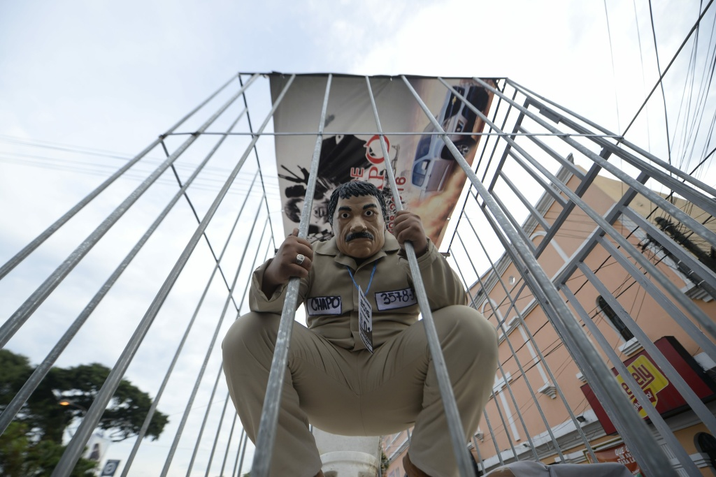 A reveler dressed as a drug trafficker Joaquin Guzman Loera aka