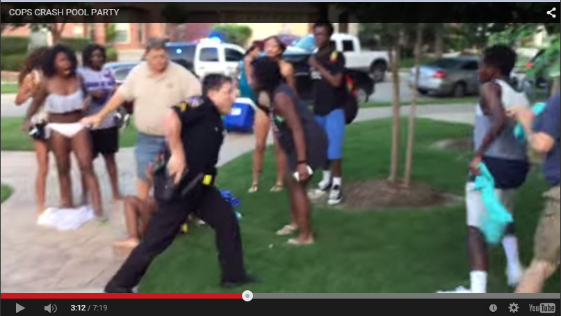 A screenshot from a bystander video shows a police officer in McKinney, Texas, drawing his weapon on teens. A bill passed in the California legislature on Thursday, July 9, 2015, says recording or photographing police in public areas isn't enough to charge people with obstructing officers.