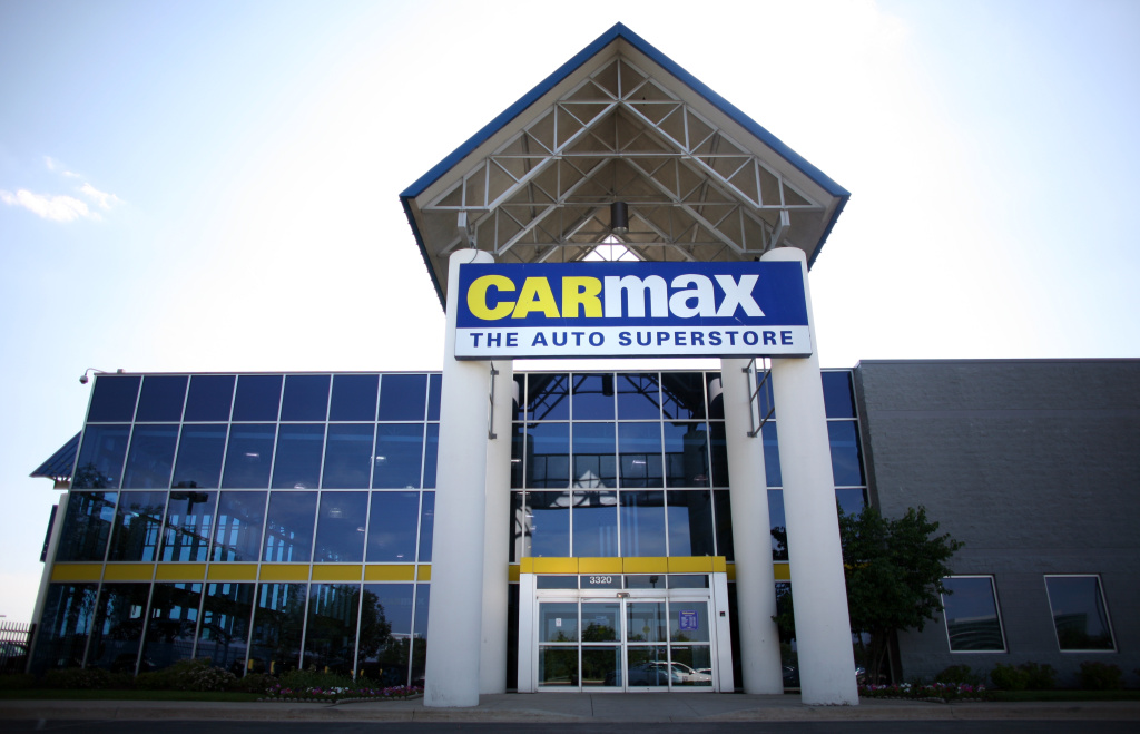 Cars sitting in the parking lot are reflected in the windows of used car retailer CarMax June 19, 2008 in Naperville, Illinois.