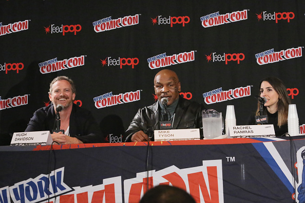 Producer/writer Hugh Davidson and actress Rachel Ramras flank Mike Tyson at the 2014 New York Comic Con.