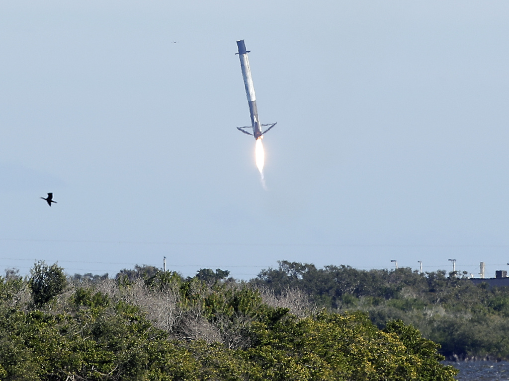 Falcon 9 rocket first stage booster experiencing control problems and missing a landing zone at Cape Canaveral, Fla.