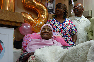 Gertrude Baines, pretty in pink, at her 115th birthday party.