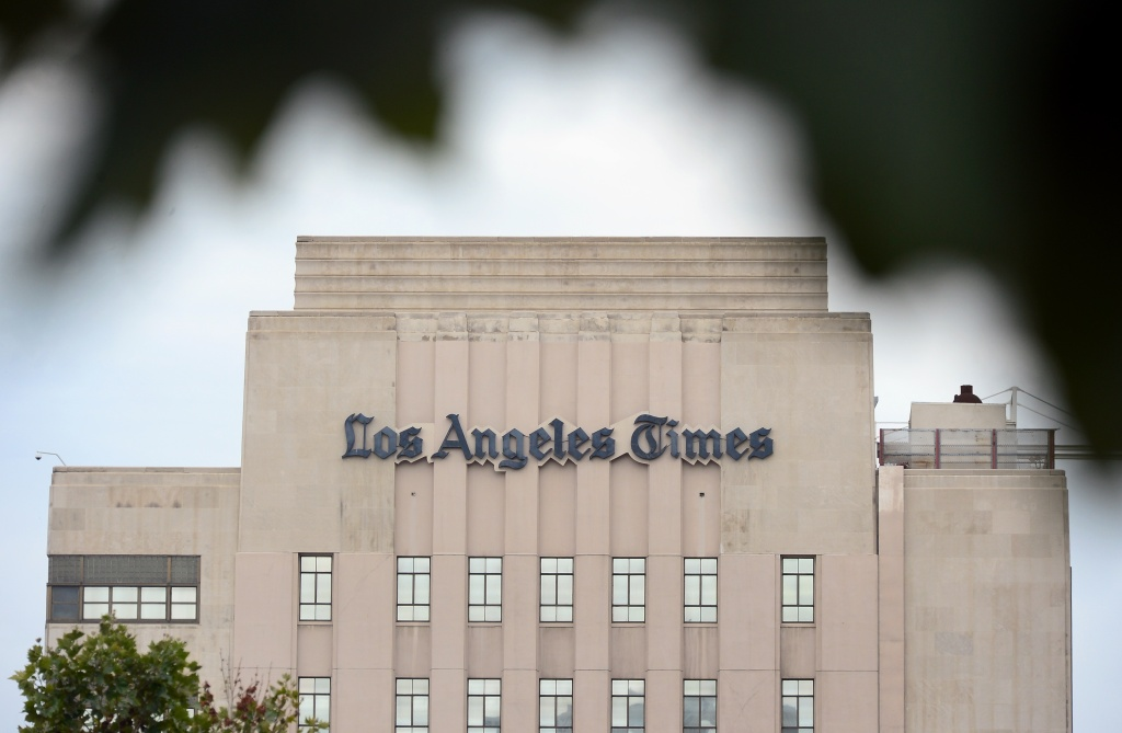 The Los Angeles Times Building is seen in downtown L.A. in this July 10, 2013 file photo. A week after naming a new CEO, Tribune Publishing is shaking up its leadership structure by combining the role of editor-in-chief and publisher at its papers, including at the L.A. Times.