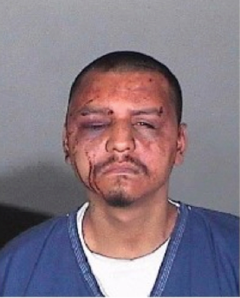 This undated evidence photo provided by the U.S. Attorney's Office shows a mug shot of Gabriel Carrillo taken by the Los Angeles County Sheriff's Department. Two former deputies were sentenced Monday to federal prison in the backroom beating of a jail visitor who fellow guards testified was handcuffed on the ground and covered in blood.