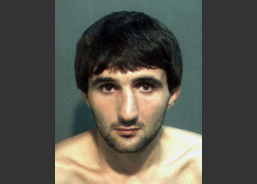 This May 4, 2013 file photo provided by the Orange County Corrections Department in Orlando, Fla., shows Ibragim Todashev after his arrest for aggravated battery in Orlando. A report released Tuesday, March 25, 2014, determined that an FBI agent was justified in fatally shooting Todashev, who became violent after he had agreed to give a statement about his involvement in a triple slaying in Massachusetts last May.