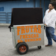 Delfino Flores unloads his cart from a pickup truck on Tuesday morning, Nov. 11, 2014.