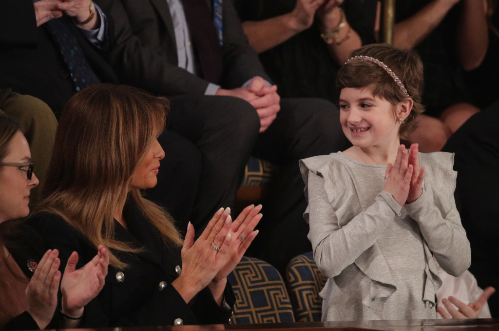 First lady Melania Trump with 10-year-old Grace Eline, a guest of President Trump at the State of the Union address Tuesday. Grace was diagnosed with brain cancer last year. Trump cited her experience in calling for more research into childhood cancer treatments.