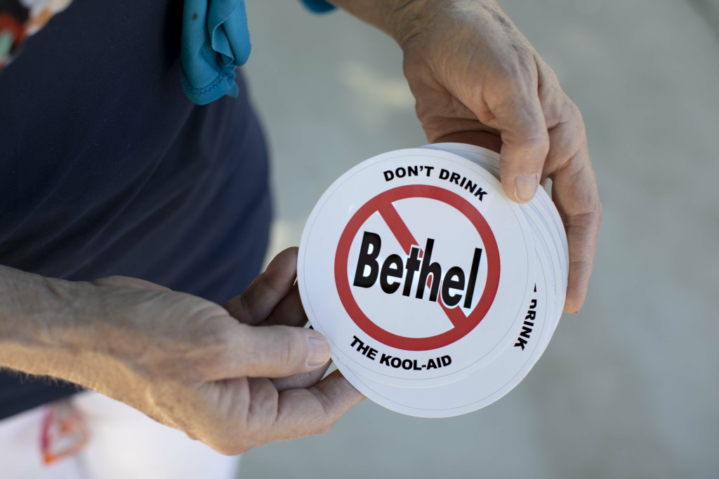 Longtime Redding resident Donna Zibull hands out anti-Bethel stickers on April 29, 2019. Zibull is a member of the Facebook group Investigating Bethel.