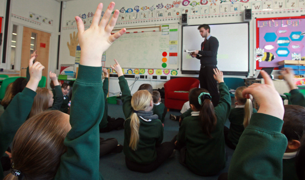 School pupils at the Bridge Learning Campus answer questions in a classroom at the school on February 24, 2010 in Bristol, England.