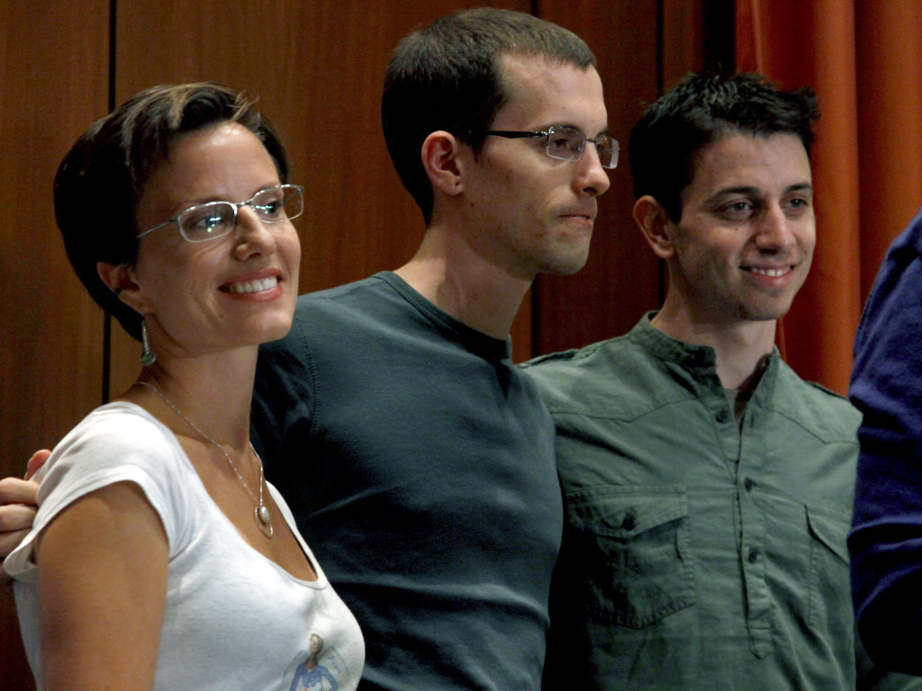 Shourd and fellow hikers Shane Bauer (center) and Josh Fattal held a press conference shortly after Bauer and Fattal were released in 2011. Shourd was released in 2010.