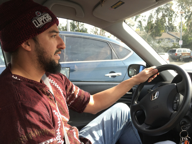 Peter Isais gets ready to drive to a cell phone repair job in Irvine. Isais, 34, depends on the work permit he has through the Deferred Action for Childhood Arrivals program.