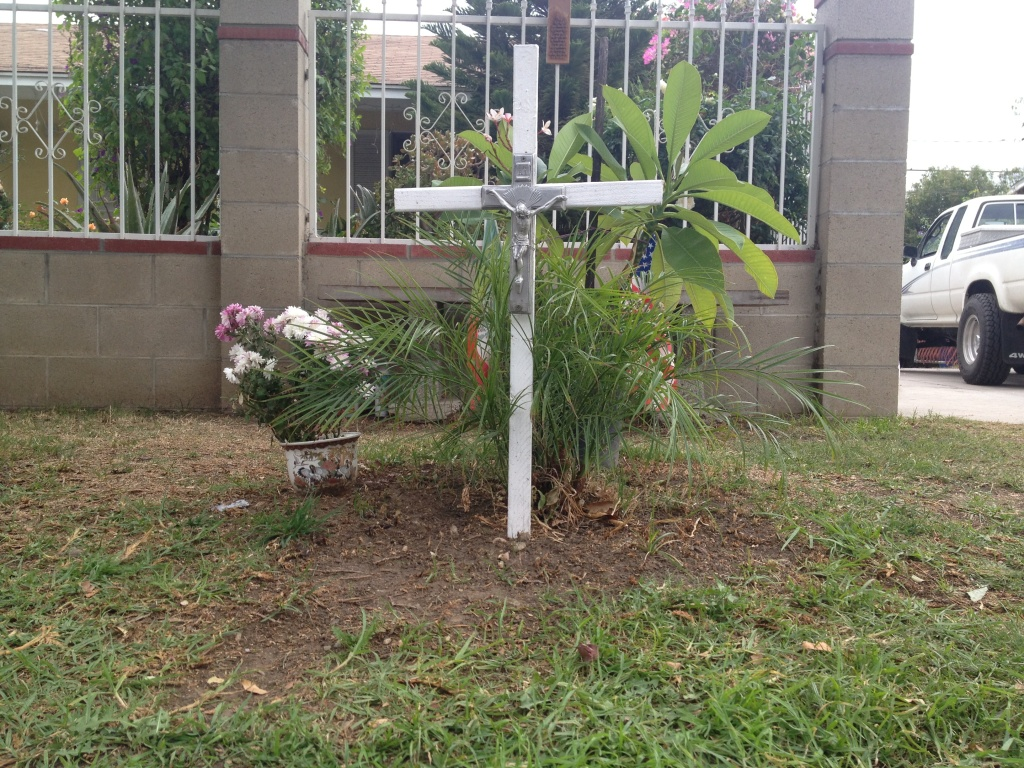 A small memorial marks the ground outside the family's home where 38-year old Armando Casillas died from one gunshot wound to the chest after a dispute with a neighbor on June. 17.