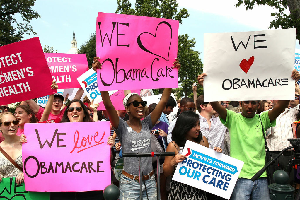 Obamacare supporters react to the  U.S. Supreme Court decision to uphold President Obama's health care law, on June 28, 2012 in Washington, DC.