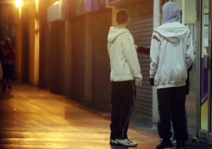Young persons in hooded tops gather on a housing estate east of Bristol city centre February 1, 2007, Bristol, England.