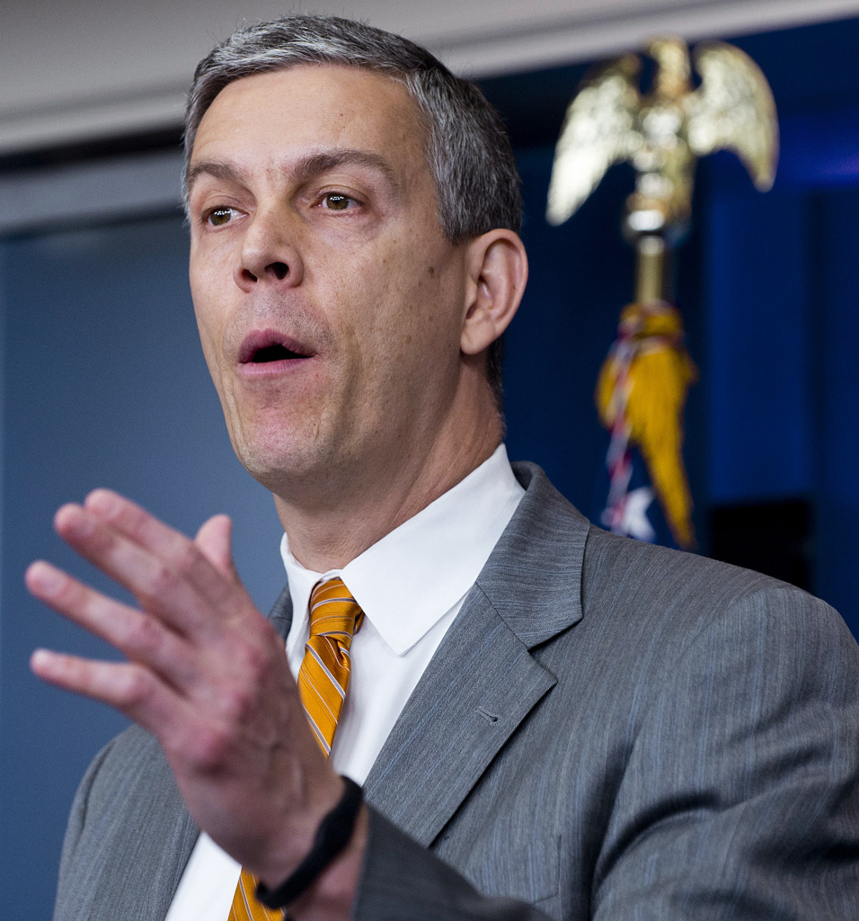 US Secretary of Education Arne Duncan speaks about student loan interest rates during the Daily Press Briefing in the Brady Press Briefing Room at the White House in Washington, DC, April 20, 2012. US President Barack Obama, with his administration, is urging the US Congress to step in and stop interest rates on federal student loans from doubling to 6.4 percent on July 1, 2012. For each year that Congress allows the rate to double, the White House said, the average student with these loans racks up an additional 1,000 USD in debt.      AFP PHOTO / Saul LOEB (Photo credit should read SAUL LOEB/AFP/Getty Images)