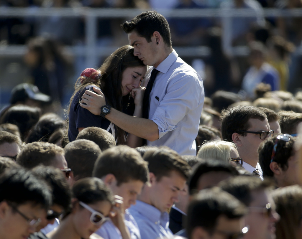 A couple embrace before a memorial service for the victims and families of Friday's rampage at Harder Stadium on the campus of University of California, Santa Barbara on Tuesday, May 27, 2014 in the Isla Vista area near Goleta, California.