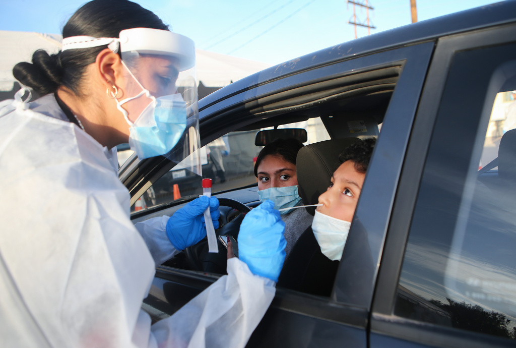 EL PASO, TEXAS - NOVEMBER 13: Frontline healthcare worker Joanne Grajeda administers a nasal swab test at a drive-in COVID-19 testing site amid a surge of COVID-19 cases in El Paso on November 13, 2020 in El Paso, Texas. Texas eclipsed one million COVID-19 cases November 11th with El Paso holding the most cases statewide. Health officials in El Paso today announced 16 additional COVID-19 related deaths along with 1,488 new cases pushing the virus death toll to 741. Active cases in El Paso are now over 30,000. (Photo by Mario Tama/Getty Images)