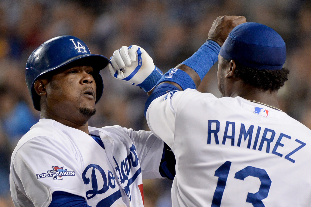 LOS ANGELES, CA - OCTOBER 07:  Juan Uribe #5 of the Los Angeles Dodgers celebrates with Hanley Ramirez #13 after Uribe hits a two-run home run in the eighth inning against the Atlanta Braves in Game Four of the National League Division Series at Dodger Stadium on October 7, 2013 in Los Angeles, California.  (Photo by Harry How/Getty Images)