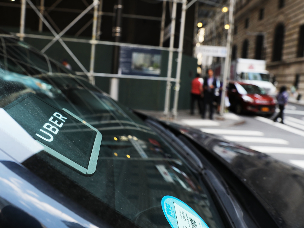 An Uber car waits for a client in Manhattan last June. Uber says customers, drivers and employees who are sexually harassed or assaulted won't have to go to arbitration, which required them to keep their stories private.