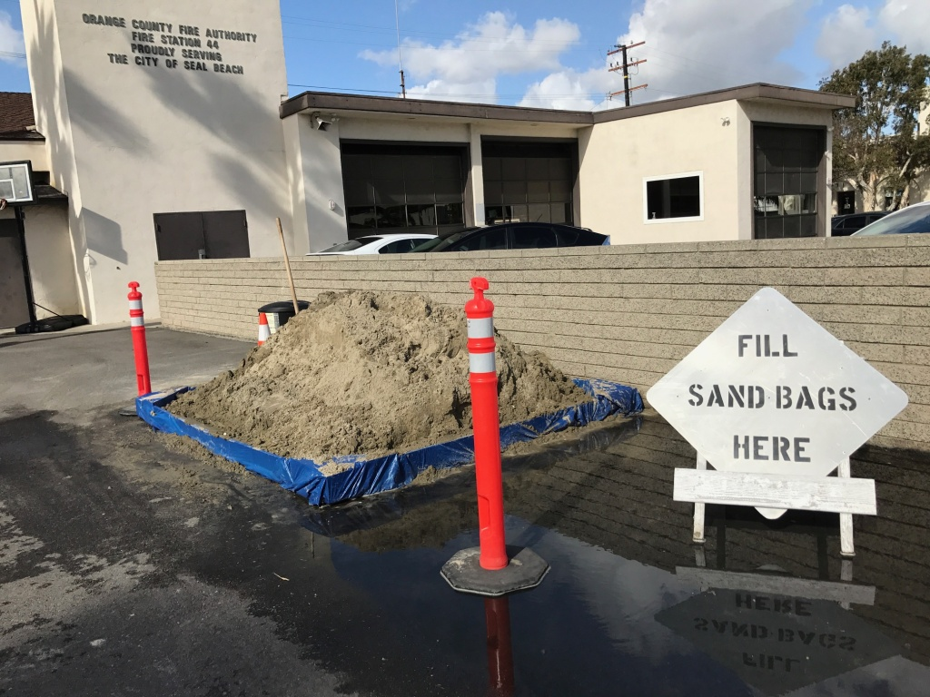 The city of Seal Beach is among the local coastal communities offering fill for sand bags to protect against flooding during the upcoming series of storms.