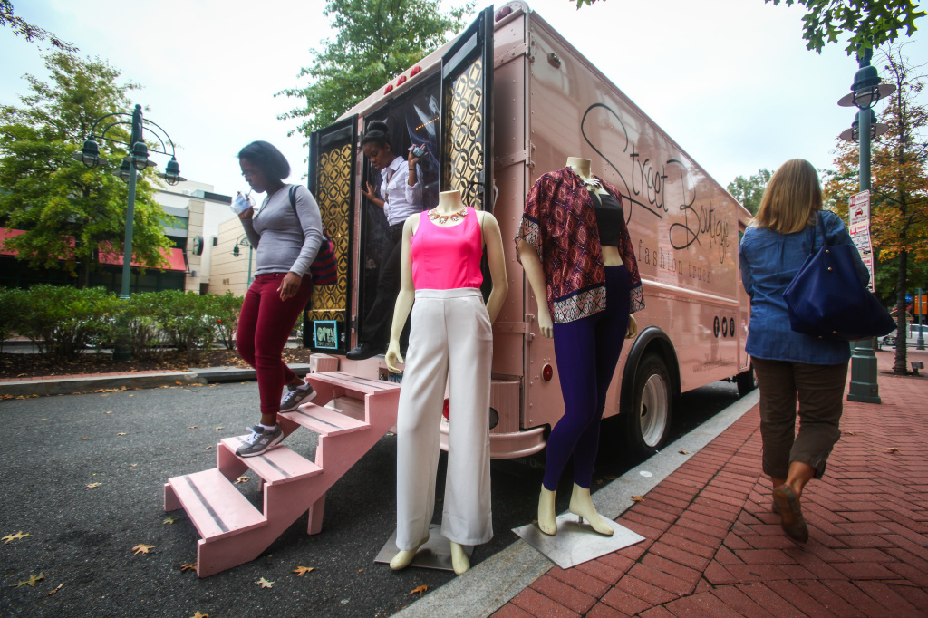 Customers walk out of Street Boutique, parked in Shirlington Village, Va. Street Boutique is a pop-up truck that's similar to the many food trucks in the area, except it sells clothes and jewelry.