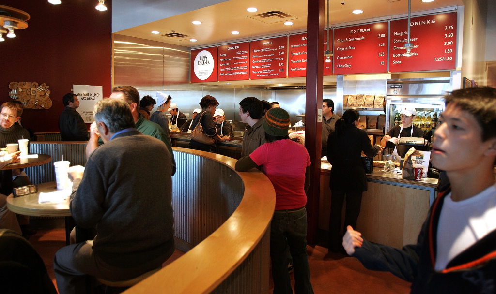Activity is seen near the order-counter area inside a Chipotle restaurant December 2, 2005 in Glenview, Illinois.