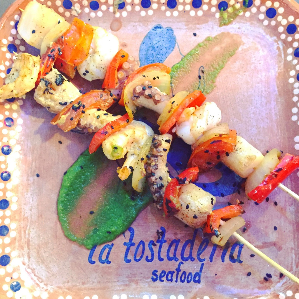 La Tostaderia at Grand Central Market serves seafood like these octopus, scallop, shrimp and vegetable skewers.