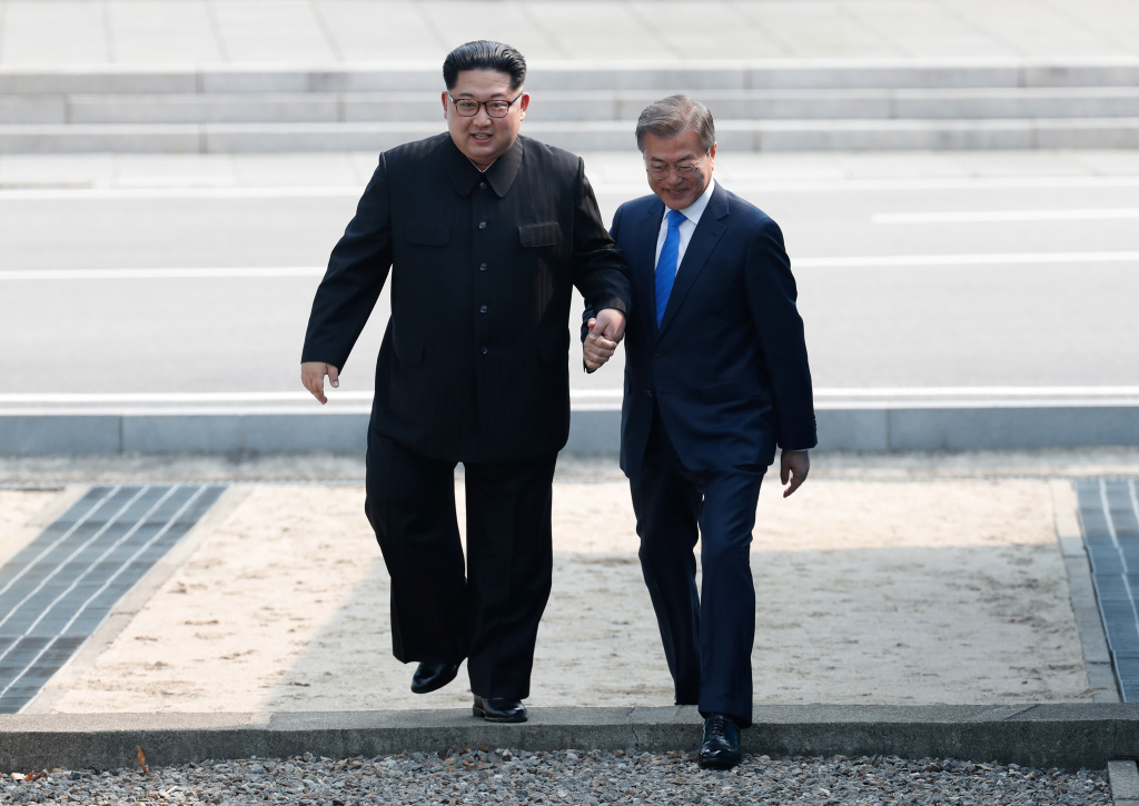North Korean leader Kim Jong Un, left, and South Korean President Moon Jae-in cross back the military demarcation line to the south side after Moon crossing the border to north upon meeting for the Inter-Korean Summit April 27, 2018 in Panmunjom, South Korea. Kim and Moon meet at the border today for the third-ever inter-Korean summit talks after the 1945 division of the peninsula, and first since 2007 between then President Roh Moo-hyun of South Korea and Leader Kim Jong-il of North Korea.