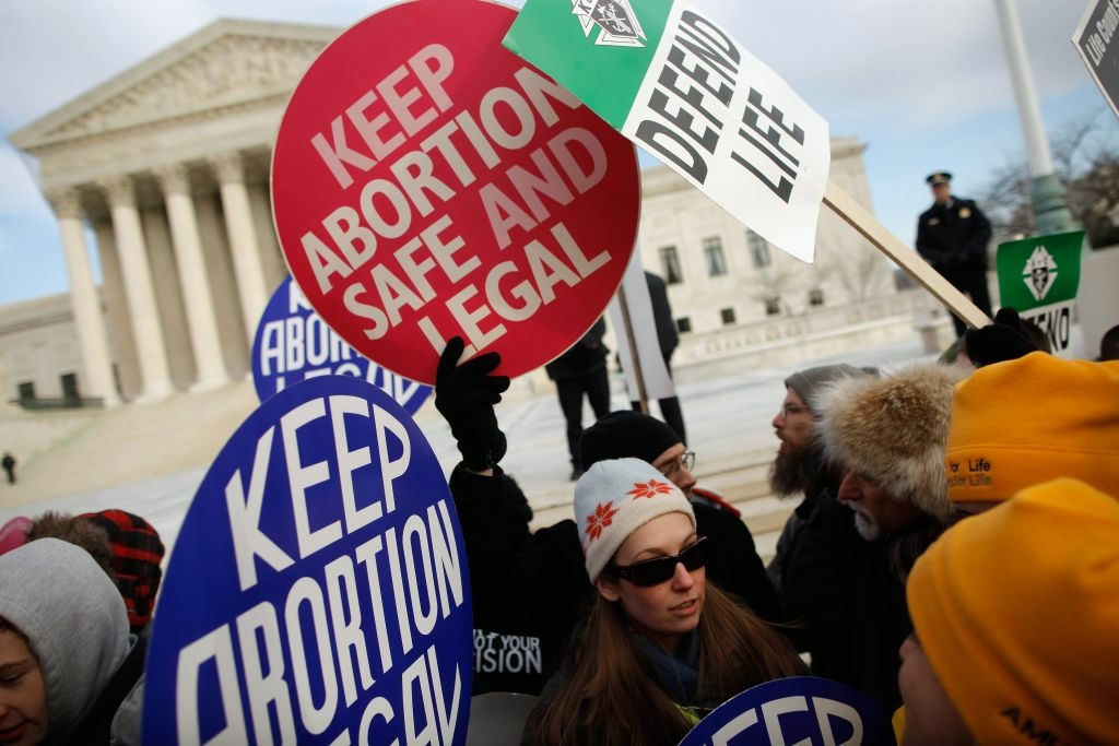 Anti-abortion and pro-choice demonstrators argue in front of the Supreme Court during the March for Life January 24, 2011 in Washington, DC. The annual march marks the anniversary of the landmark Roe v. Wade decision by the court that made abortion legal in the United States.