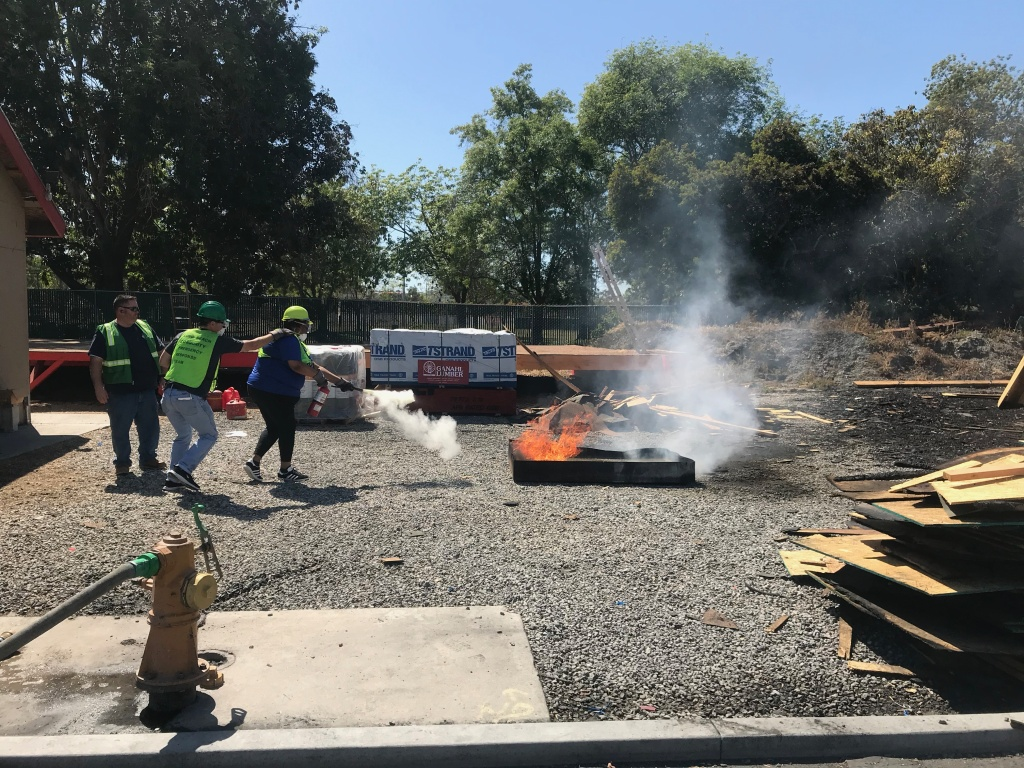 Danica Potts puts out a fire. This earthquake drill is a chance for the participants to practice in real life what they've learned over the weekend of CERT training.