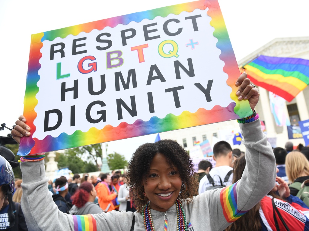 A new report by GLAAD highlights the high rate of harassment and hate facing LGBTQ users on social media. In this photo, demonstrators rally in favor of LGBTQ rights outside the U.S. Supreme Court in Washington, D.C., in 2019.