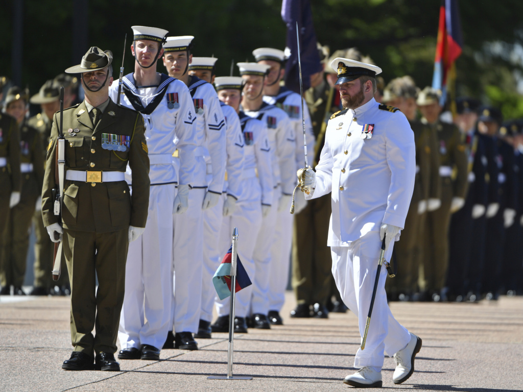 An honor guard is formed at Defence Headquarters in Canberra, Australia, before findings from the Inspector-General of the Australian Defence Force Afghanistan Inquiry are released on Thursday. A report found evidence that 25 soldiers unlawfully killed 39 Afghan prisoners, farmers and civilians.