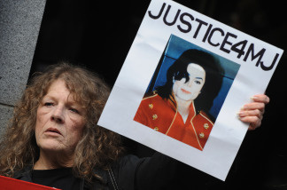 File photo: Michael Jackson fans call for justice outside the Los Angeles Superior Court before Doctor Conrad Murray's second court appearance on an involuntary manslaughter charge relating to the death of Michael Jackson, in downtown Los Angeles on April 5, 2010.