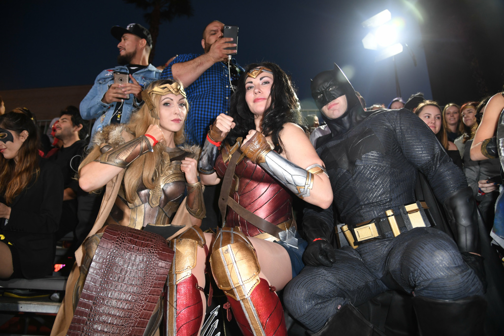 Fans in costume attend the world premiere of Warner Bros. Pictures'