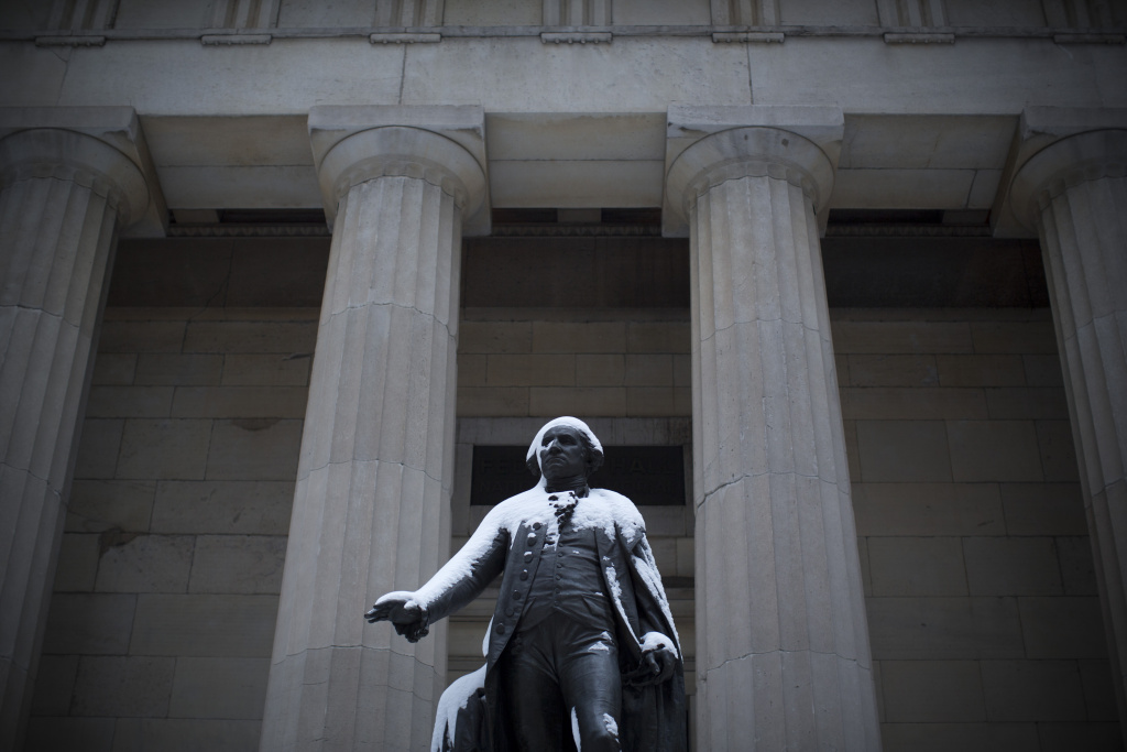 A statue of George Washington at Federal Hall is covered in snow following a major winter storm on February 9, 2013 in New York City.