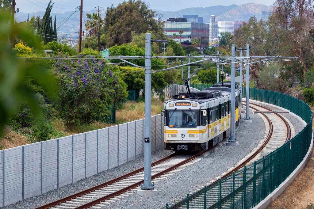 File: A test train passes through the Northvale Trench between the 10 freeway and Overland Avenue along the new Expo Line extension on May 6, 2016.
