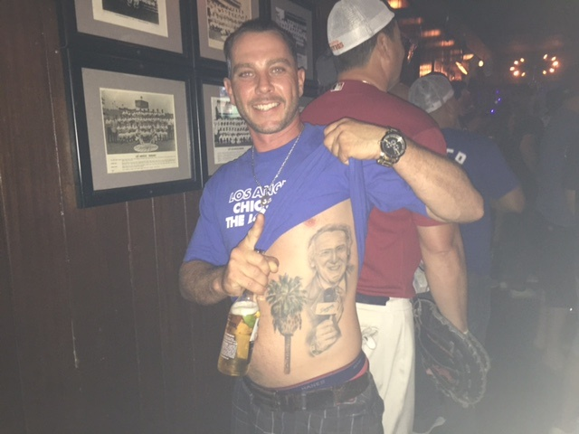 Mark Morocco of Palm Springs shows off his Vin Scully tattoo at the Short Stop bar during Game 1 of the 2017 World Series.