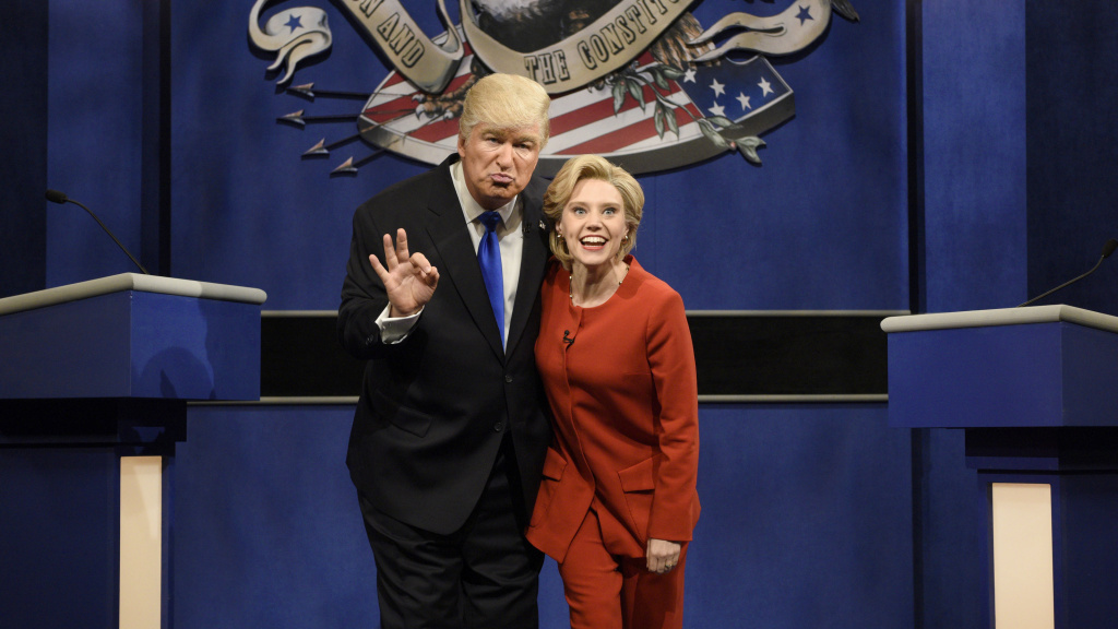 Alec Baldwin as Donald Trump and Kate McKinnon as Hillary Clinton keep in character during SNL's cold open sketch that parodied Monday's presidential debate.