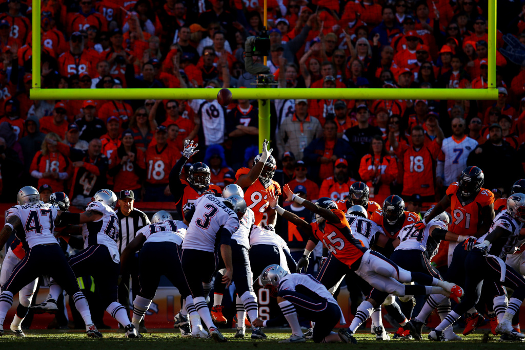 Stephen Gostkowski #3 of the New England Patriots kicks an extra point in the fourth quarter against the Denver Broncos during the AFC Championship game at Sports Authority Field at Mile High on January 19, 2014 in Denver, Colorado.