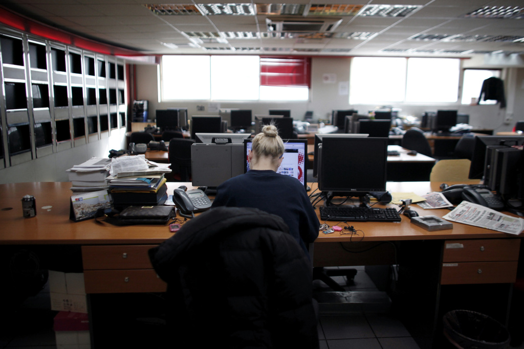 An employee sits at her desk.