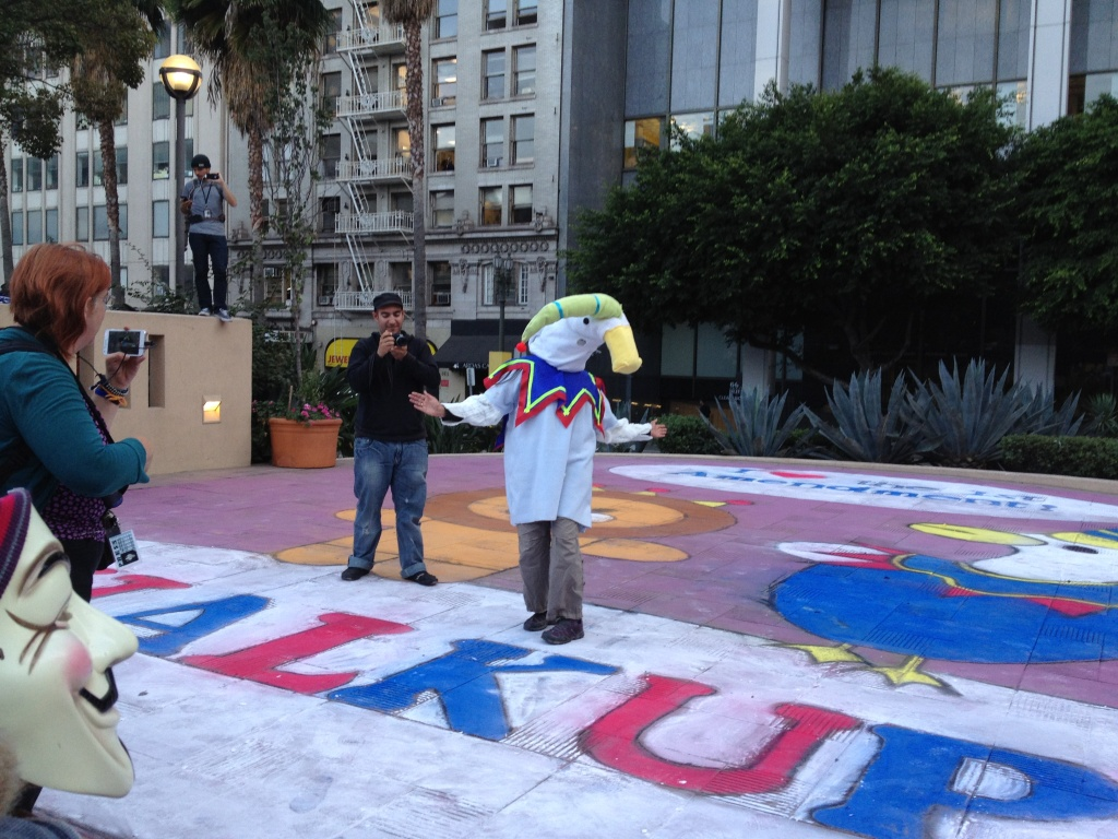 Members from Oakland's Fresh Juice Party chalked up Pershing Square with a huge drawing before that evening's Art Walk event held in August.