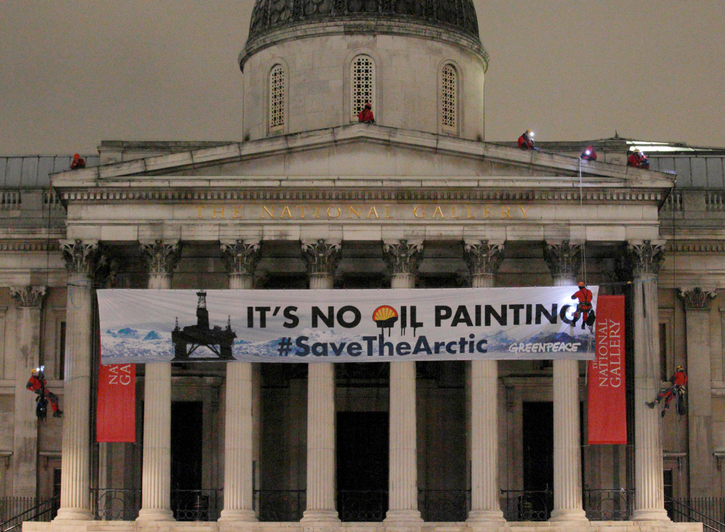 Greenpeace protesters scale the pillars of the National Gallery in central London, on February 21, 2012, as they unfurl a banner in protest at what they claim are Shell's plans for drilling oil in the Arctic region.