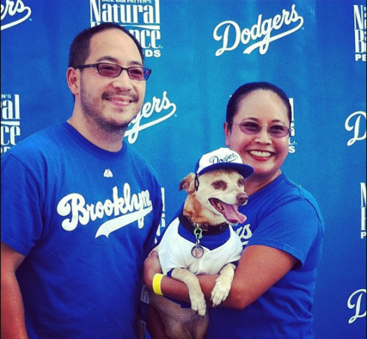 Dodger fans pose with their pup Saturday, May 11 at Dodger Stadium. Photo submitted by @spcaLA.