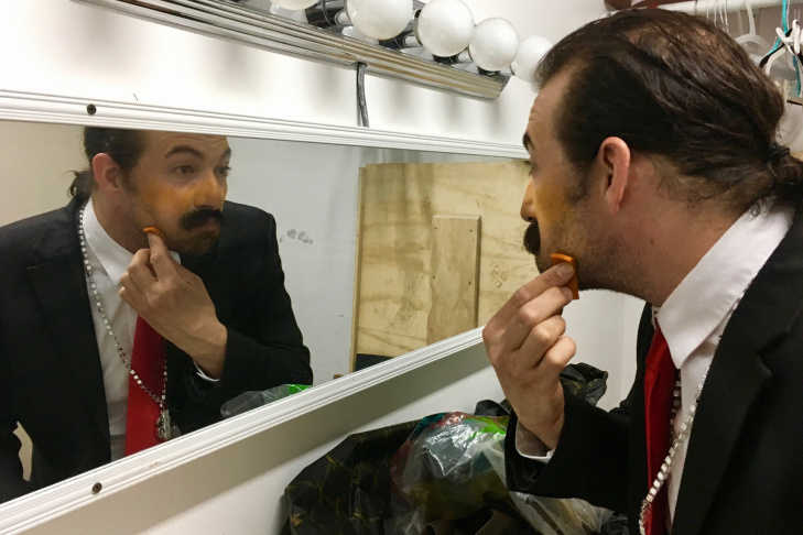 Chris Corbin gets ready on a recent Wednesday night for the Pack Theater's Trumprov show, a monthly show that features Donald Trump as an improvisor.