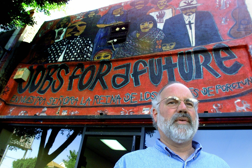 Jesuit Priest Father Greg Boyle poses outside the 'Jobs for a Future' employment center he runs for Latino gang members who want out of a life of crime and gangs on December 18, 2000 in the East Los Angeles neighborhood of Boyle Heights. East LA is home to 60-odd street gangs totalling 10,000 members.