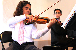 Cameron Mittleman at the violin with Alex Mansour at the piano rehearse for the Young Artist Alliance Charity Concert at the Pasadena Conservatory of Music to benefit the Haiti earthquake victims on May 30,2010.