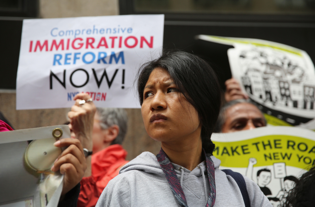 Immigration reform advocates stage a demonstration outside a detention facility run by Immigration and Customs Enforcement (ICE) on June 14, 2013 in New York City.